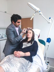 dr anil administering botox to a patient at the west london clinic